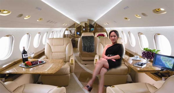 Rich woman sitting in a private jet