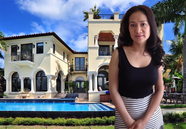 Rich woman standing in front of the luxury villa