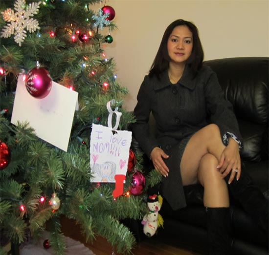 Asian woman at Christmas tree